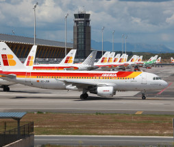 Madrid, Spain - April 24, 2011: An Iberia Airbus A320 with the registration EC-JSB taxis in front of Terminal 4 at Madrid airport (MAD). Iberia is the largest spanish airline with 104 planes and 24 million passengers in 2010. Its headquarters is at Barajas airport in Madrid. In 2010 Iberia has signed an agreement to merge with British Airways.
